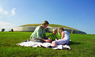Family with newgrange in the background